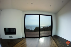 White Paint in Malibu, Simple Modern Design, notice there are no Baseboards, Crown Moulding or Trim Work of any kink.